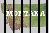 Montana behind bars.